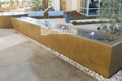 Featured here is a beautiful water feature that was created using Bomanite integrally colored concrete that was installed with a smooth trowel finish and is a perfect complement to the tranquil and therapeutic design aesthetic.