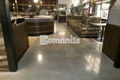 Modena by Bomanite was installed here using custom black and brown pigments that were mixed for the final color placement and once cured, the flooring was ground and polished to a medium satin finish and given two coats of Bomanite Stainguard to create a custom polished concrete flooring surface with distinctive beauty and durable protection.