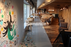 After reviewing a series of Bomanite Custom Polishing Modena SL samples, Starbucks chose us to install a Bomanite Modena SL decorative concrete overlay inside this Kansas City store and our coordination with one of their artists to utilize a portion of the floor as a canvas to paint a fun, colorful mural helped us to create an interplay of color and sophistication that showcases the flexibility and decorative nature of Bomanite architectural concrete.