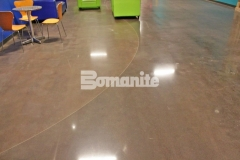 Featured here is the Bomanite Patene Teres Custom Polishing System that was used to create distinctively beautiful decorative concrete flooring that adds a beautiful and warm design aesthetic to this church space while providing a durable surface that will hold up to heavy foot traffic.