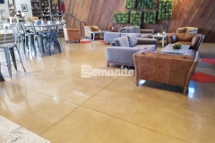 Bomanite Patene Teres custom polished concrete is featured here, and the beautiful, high-gloss finish adds an element of sophistication that blends seamlessly with the contemporary design aesthetic.