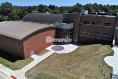 Featured here is Bomanite Alloy decorative concrete that was installed at Harrisburg High School to create a highly durable paving option with the addition of beautiful, exposed aggregates to add sparkle to the hardscape.