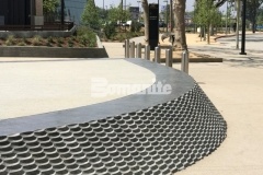 The Bomanite Alloy Exposed Aggregate System was used here to create contrasting bands of decorative concrete with the addition of clear glass aggregates and reflective mirror flakes to add intricate, eye-catching detail to this stunning hardscape surface.