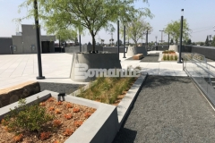 Bomanite Exposed Aggregate Sandscape Texture was used here to add a textural finish to these lineal planters and circular tree planters and this distinctive design element is a perfect to this rooftop terrace and garden.