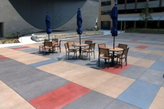 A beautiful vibrancy was added here by installing Bomanite Sandscape Texture decorative concrete with a unique stain pattern that creates visual interest and character in this outdoor gathering space.