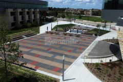 This custom stained Bomanite Sandscape Texture decorative concrete hardscape perfectly complements the surrounding architecture with beautiful design details that create continuity throughout the space.