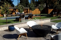 Bomanite Sand Color Hardener and Bomanite French Gray Release Agent were used in conjunction with Bomanite Bomacron imprinted concrete to create a durable and decorative hardscape surface that is a charming design element in this backyard retreat.