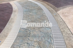 A meandering brook concept was created at Canobie Lake Park using Bomanite stamped concrete that was expertly installed by our colleague, Harrington Bomanite, and includes serpentine drains that infiltrate storm water and minimize runoff while accentuating the decorative concrete decking at the Castaway Island water feature.