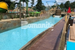 The Bomanite Bomacron Boardwalk pattern and was used here to create a durable hardscape surface with dimension and texture that adds a beautifully distinctive design aesthetic to the stamped concrete lifeguard walk at this outdoor water park.