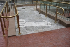 Bomanite Bomacron was installed here in the Medium Ashlar Slate pattern to create a pedestrian bridge and wheelchair access ramps and this durable concrete surface is a functional asset that adds a beautiful design aesthetic to this space.