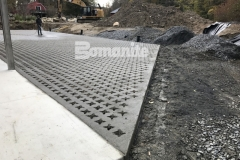 This charming hardscape surface features Bomanite Grasscrete pervious concrete that was installed at this residence to create access for large delivery vehicles while providing a permanent solution for stormwater management.