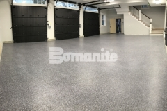 Bomanite Broadcast Flake was the perfect solution in this garage to correct an improperly poured foundation and will serve as a long-standing protective flooring surface for the homeowner.