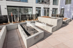 Bomanite Micro-Top ST was installed here to create a durable concrete overlay on these tiered planter walls, providing a low maintenance option that is resistant to ultra-violet degradation from long-term exposure to sunlight, making it an economical choice for a decorative, textured surface.